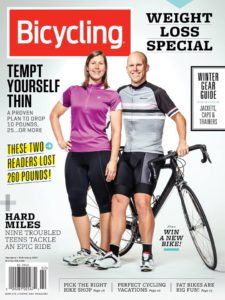 Cover the the Bicycling Magazine featuring a woman and a man with a bicycle
